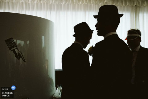 Black and white photo of men in bowler hats by a Greater Manchester, England wedding reportage photographer.