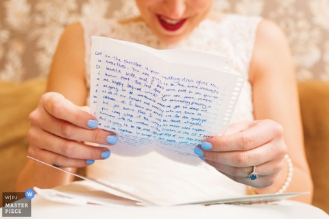 A detail photo of the bride reading a hand-written letter by a New Jersey wedding photographer.