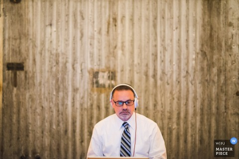 Photo of the DJ with his headphones on by a Washington, D.C. wedding photographer.
