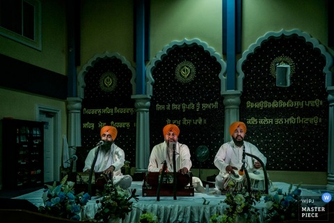 Photo of three musicians performing on a platform by a Toronto wedding photographer.