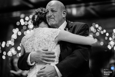 Saratoga Springs wedding photographer captured this emotional black and white image of a father tearing up during the father daughter dance