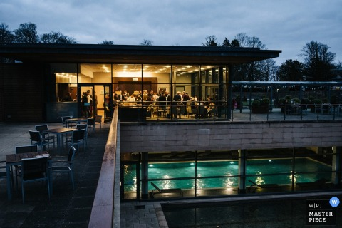 Scotland wedding photographer captured this far away image of a wedding reception at a pool