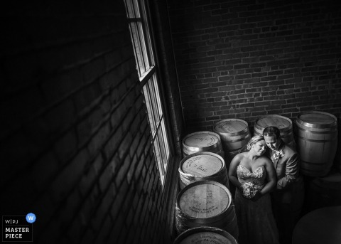 New Jersey wedding photographer created this black and white overhead portrait of the bride and groom in a winery
