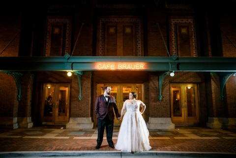 Creative night portrait of the bride & groom outside Cafe Brauer in Chicago.