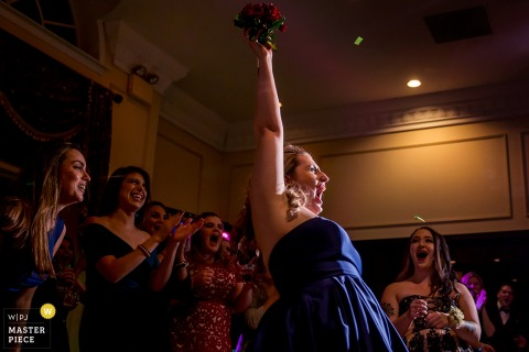 Chicago wedding photographer captured this photo of an ecstatic wedding guest who caught the bouquet