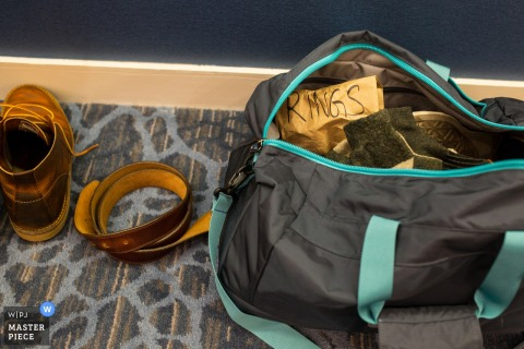 Chicago wedding photographer created this detail shot of a grooms packed bag before the wedding