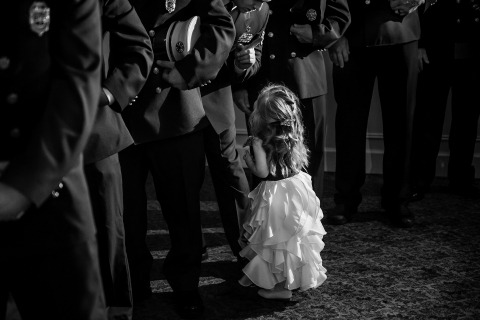 Janine Grimm, a New Jersey wedding photojournalist, made this photo during the military ceremony of a flowergirl.