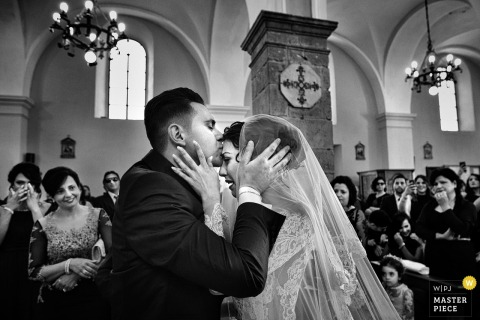 Calabria wedding photographer created this emotional black and white profile image of a groom kissing the bride