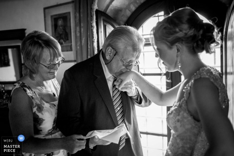 Florence wedding photographer captured this emotional black and white image of the brides father kissing her hand