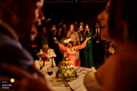 Florence wedding photographer created this picture of a wedding guest behind the bride and groom