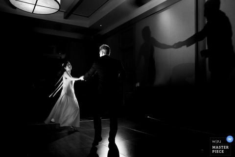Lake Tahoe wedding photographer captured this black and white image of a dancing bride and groom and their shadows