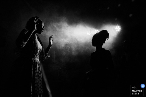 Florence wedding photographer created this black and white picture of a wedding guest dancing in the spotlight