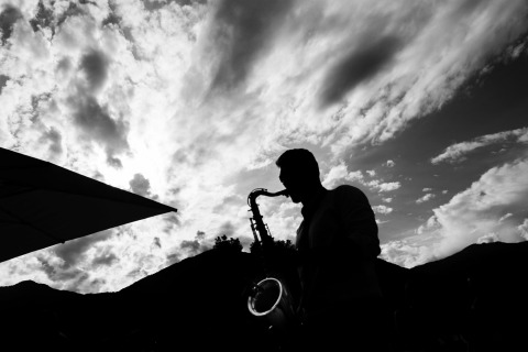 A musician's silhouette against sky. Black and white photo by Matteo Reni of Varese, Italy.