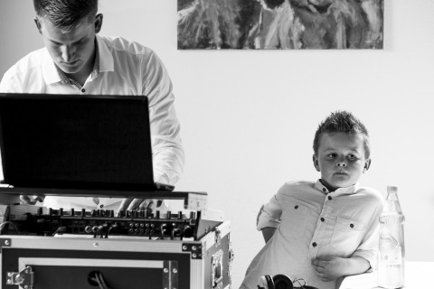 Kid by DJ's stand. Black and white photo by Patrick Engel of Germany.