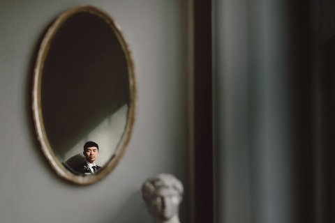 Blazej Sendzielski is a Wedding and Portrait Photographer based in New York. This is a portrait he made on wedding day of the groom reflected in a mirror.