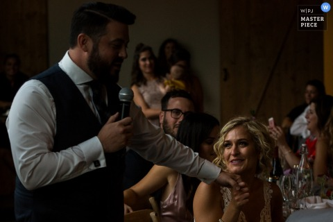 Missoula wedding photographer captured this image of a bride staring lovingly at her groom as he recites his speech at the reception
