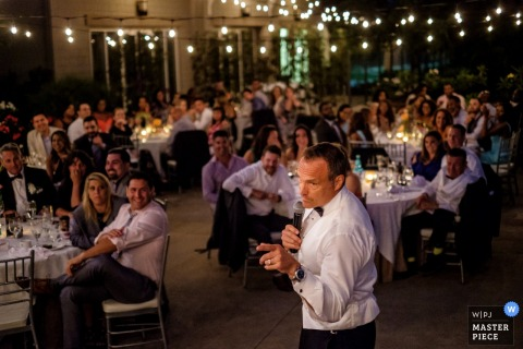 San Diego wedding photographer captured this photo of the wedding guests listening and laughing to a speech