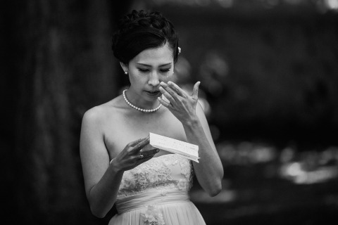 France Wedding Photographer David Pommier made this black and white image of a bridesmaid crying during her speech.