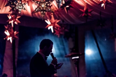 Award winning WPJA Wedding Photographer Brett Butterstein of California comes well prepared to the reception to make amazing photos like this toasting speech in great lighting.