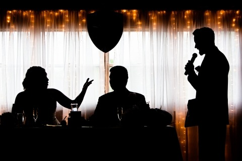 New Jersey Wedding Photographer Todd Laffler makes interesting silhouetted images like this one during the speeches at the wedding.