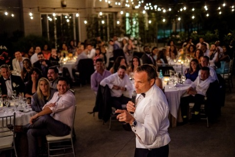 California Wedding Photographer Shaun Baker recorded this father of the bride gesturing toward the couple during the wedding reception.