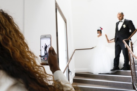 Wedding Photographer Laure Boyer photographed this bride and groom coming down the stairs at their wedding reception in France