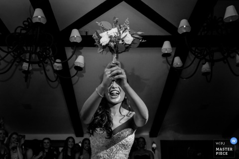 San Diego wedding photographer captured this black and white photo of the brides face as she waits in anticipation to throw her bouquet