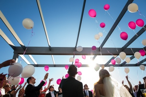 Vitaly Nosov of Hamburg, Germany is a Reportage Wedding Photographer that is gifted in capturing wedding traditions, like the releasing of balloons.