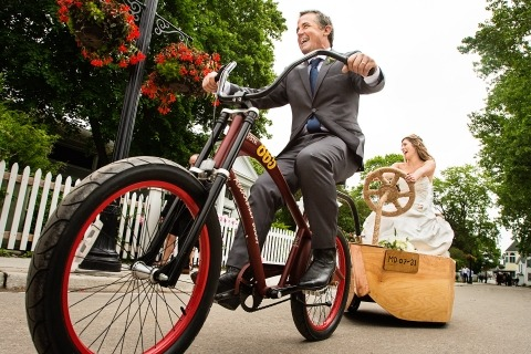 Todd Laffler is a New Jersey Wedding Photographer that likes to roll with the action surrounding the bride and groom, like this ride on their bike.