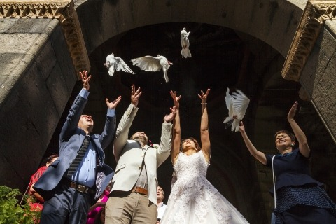 Documentary Wedding Photography by Albert Buniatyan of Yerevan, Armenia captured the releasing of doves following the wedding ceremony.