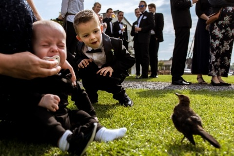 Wedding Photographer Isabelle Hattink is from The Netherlands and uses her documentary-style to capture moments like these boys playing with a bird.