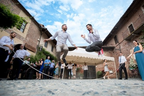 Sergio Bruno is a Wedding Photographer from Italy that specializes in his own documentary style, like this photo of the guys jumping rope.