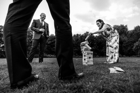 United Kingdom Wedding Photographer Paul Rogers capured the game Jenga, stacked wooden blocks, at this wedding reception in Hertfordshire