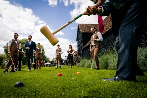 Hertfordshire, UK Reportage Wedding Photographer Paul Rogers captured this reception game of croquet.
