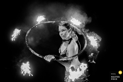 Phoenix wedding photographer captured this black and white photo of a woman performing with a flaming hula hoop