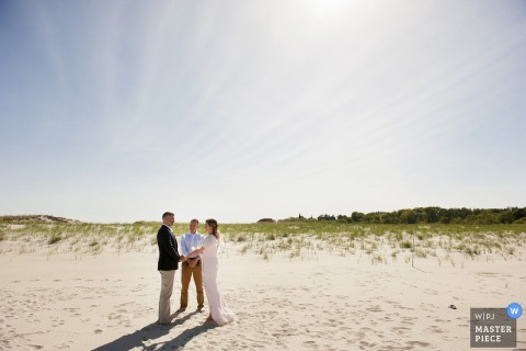 Boston wedding photographer captured this intimate beach ceremony under a cloudless sky