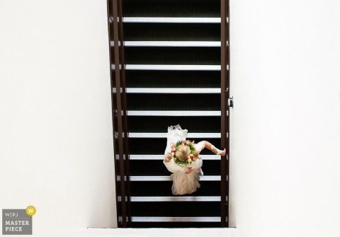Carson City wedding photographer captured this overhead shot of the bride walking on a flight of stairs while wearing a floral crown