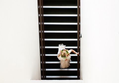 Nevada Wedding Photographer Tara Theilen captured this bride coming down the stairs alone in Carson City.