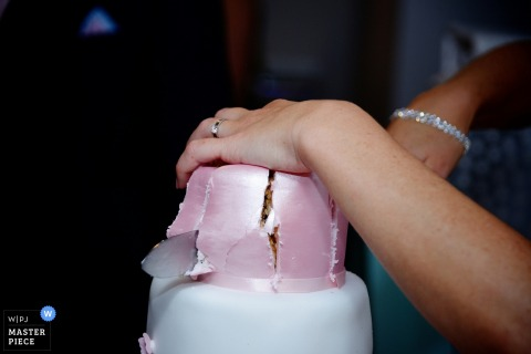 This detail shot of a knife slicing the wedding cake was captured by a Hampshire wedding photographer