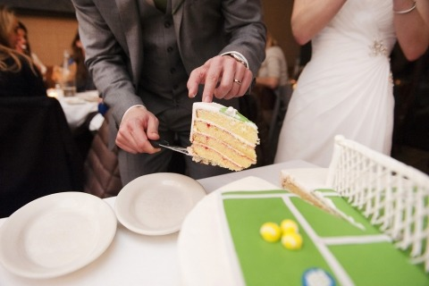 Massachusetts Wedding Photographer Simi Rabinowitz made this image of a tennis court cake being cut by the bride and groom
