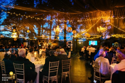 London wedding photographer captured this image of the warm ambiance at this outdoor tented reception