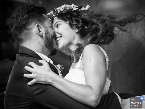 Milan wedding photographer captured this photo of the bride and groom smiling at each other while they twirl during their first dance