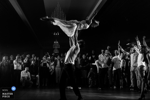 Porto wedding photographer captured this dramatic image of the bride and grooms first dance as he twirls her above his head