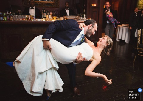 Brooklyn wedding photographer captured this image of the bride looking at her groom in surprise as he dips her during their first dance