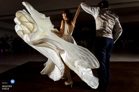 Hertfordshire wedding photographer captured this bride and groom in mid-twirl as her dress billows around her
