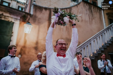 Padua wedding photographer captured this photo of a proud wedding guest after he caught the bouquet
