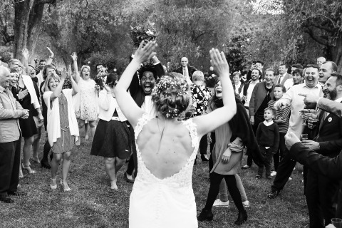 After tossing her bridal bouquet, Wedding Photographer Laure Boyer of France documented this bride celebrating with her wedding guests.