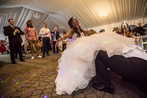 Scott Schoeggl is a Washington Wedding Photojournalist that makes interesting images like this one of the groom trying to find the garter under the brides dress.
