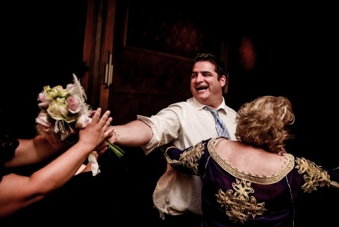 Canadian Wedding Photographer Anderson Lima shot this image at a Quebec wedding reception of a brides bouquet after the catch.