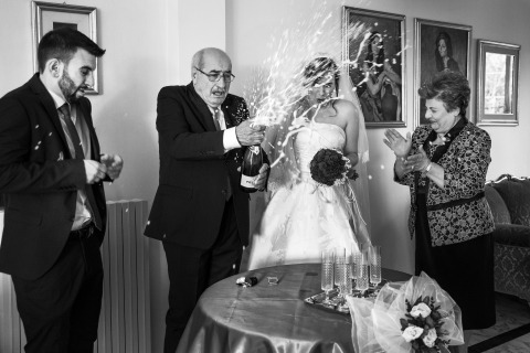 Raffaella Arena of Cosenza, Italy shot this wedding day photogaph of a bride with her parents about to enjoy some champaign.